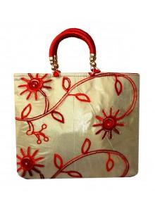 red embroidered net golden tissue purse