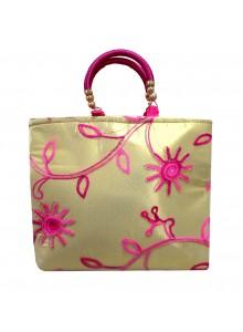 pink embroidered net golden tissue purse