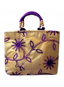 purple embroidered net golden tissue purse